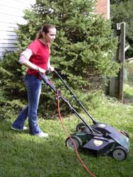 Woman mows grass