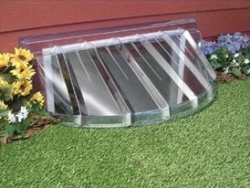 Window well with plastic cover.