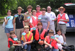 boy scout group holds up storm drain labels