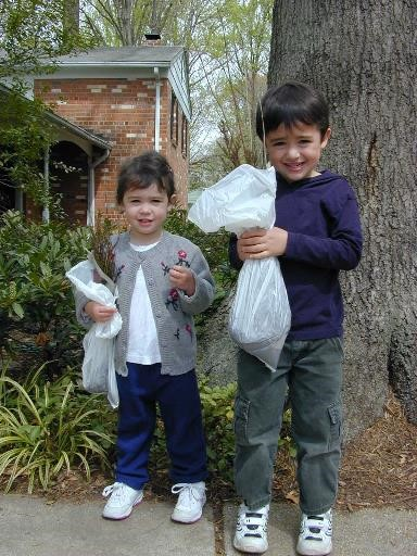 Small boy and girl hold seedling packages