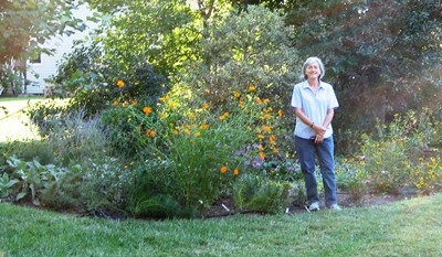 Gretchen Stark with her rain garden, six months after construction.